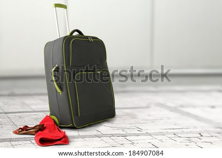 suitcase and red decoration  - stock photo