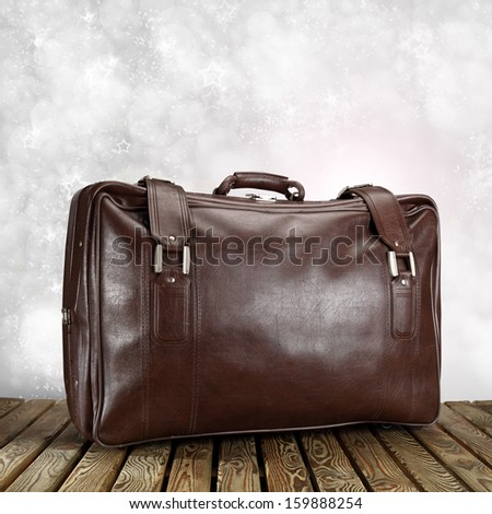 suitcase and winter space  - stock photo