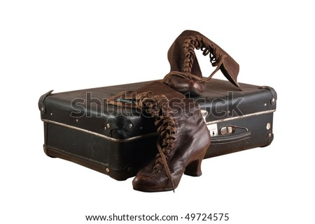suitcase on white boots