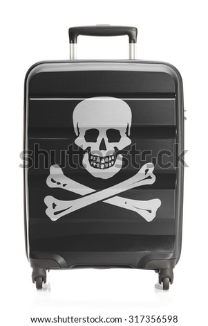 Suitcase painted into Jolly Roger flag - symbol of piracy - stock photo
