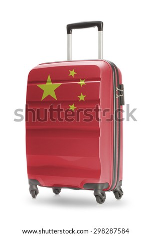Suitcase painted into national flag - China - stock photo