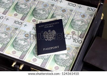 Suitcase passport and polish money corruption and escape concept - stock photo