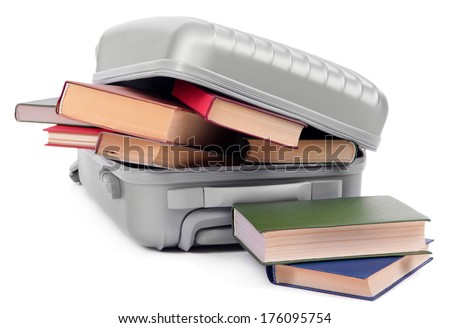 Suitcase with books isolated on white
