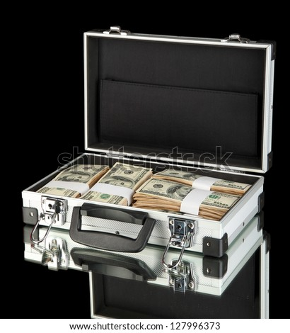 Suitcase with 100 dollar bills on black background