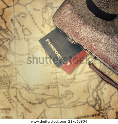Suitcase with passports - stock photo
