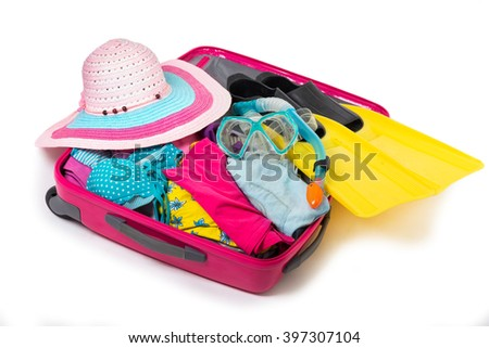 Suitcase with things on a vacation - stock photo