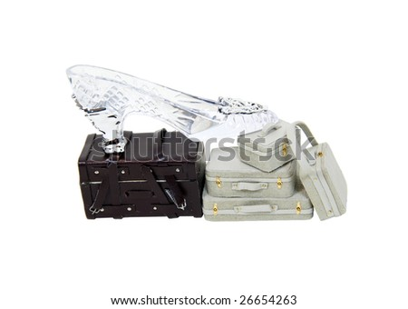 Suitcases and baggage to carry clothing and essentials when traveling and a crystal slipper for fashion and style-Path orig size - stock photo