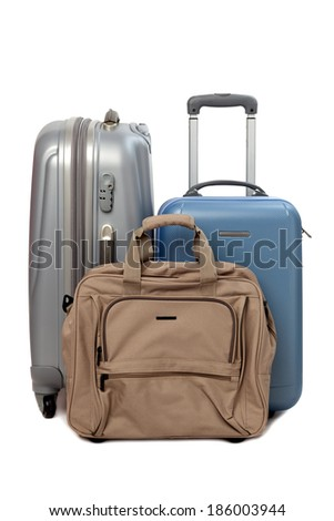 Suitcases and travel bag isolated on white background - stock photo