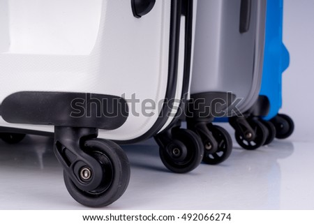 Suitcases on wheels of different colors