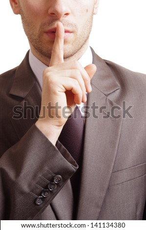 suited man with a gesture of shh on white background - stock photo
