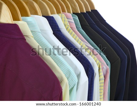 Suits and shirts on hanger isolated on white