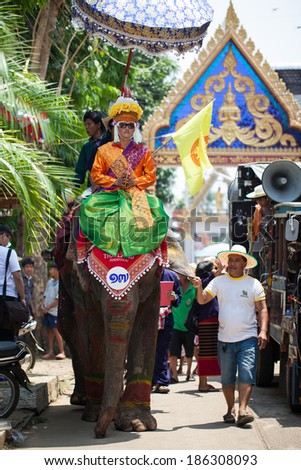 SUKHOTHAI - APRIL 7 : Songkran Festival and Had Siew Elephant Ordains at Si Satchanalai from April 7 to 8, Riding on elephant and Thai Puan elephant ordination on April 7, 2014 in Sukhothai,Thailand.
