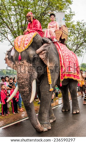 SUKHOTHAI,THAILAND - NOVEMBER 6 : Beauty queen sit on elephant join the parade of Loy Kratong festival on November 6 ,2014.Loy Kratong festival happen in all of Thailand.
