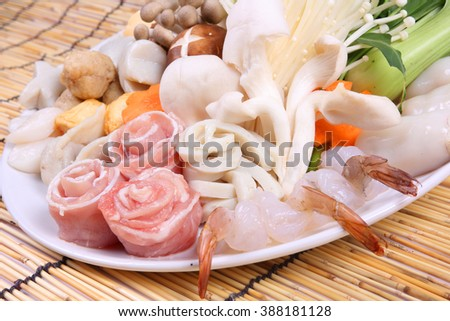 Sukiyaki Fresh Beef pork slices,fish  - stock photo