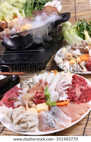Sukiyaki Fresh Beef pork slices,fish , Japanese Food shabu shabu - stock photo