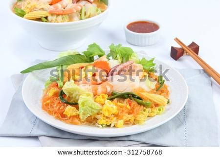 Sukiyaki with seafood on white Background - stock photo