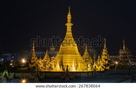 Sule pagoda, Yangon, Myanmar.  Myanmar (Burma) is the most religious Buddhist country in terms of the proportion of monks in the population and proportion of income spent on religion. - stock photo