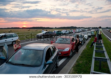 Sulechow, Poland. 30th JULY, 2015. People waiting in a traffic jam on an expressway S3 due to a car accident. - stock photo