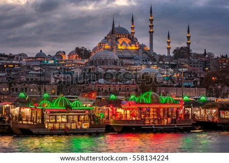 Suleymaniye Mosque shot at blue hour with colorful boats, Istanbul, Turkey.