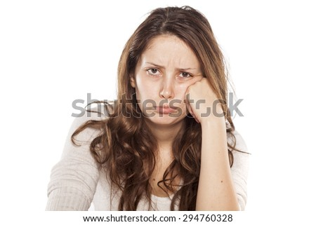 sulk young woman on a white background