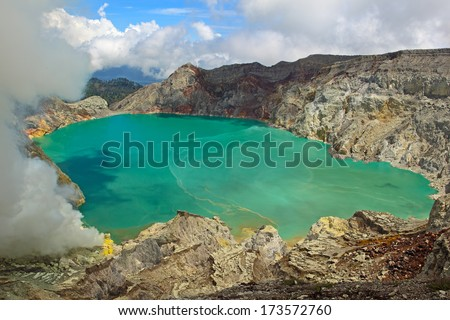Sulphatic lake in a crater of volcano Ijen. Java. Indonesia  - stock photo