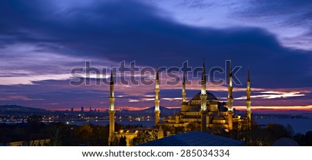 Sultan Ahmed Mosque at sunrise. Blue Mosque in Istanbul city illuminated with night spotlight and amazing sunrise sky on background. - stock photo