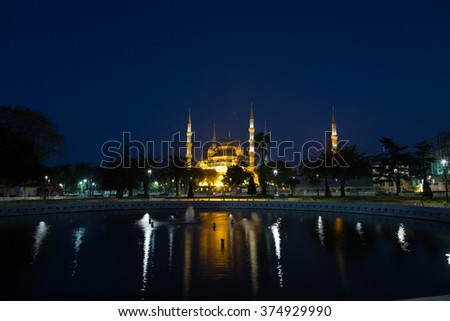 Sultan Ahmed Mosque with reflection in water at night, Istanbul - stock photo