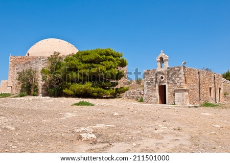 Sultan Ibrahim mosque and church of Agia Ekaterini on Crete, Greece. Rethymno city. Crete, Greece. - stock photo