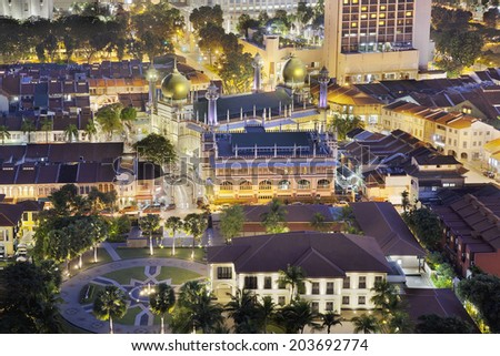 Sultan Mosque in Malay Kampong Glam at Night Aerial View in Singapore - stock photo