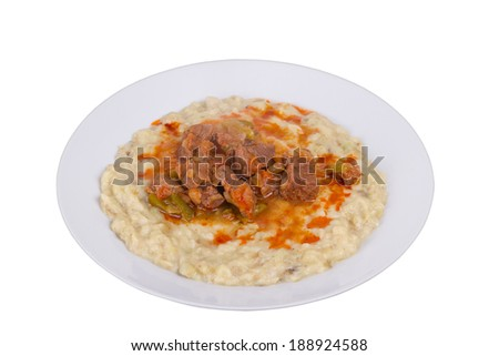 Sultans Delight from Ottoman Cuisine. Lamb Stew Served on a Bed of Aubergine Puree - stock photo