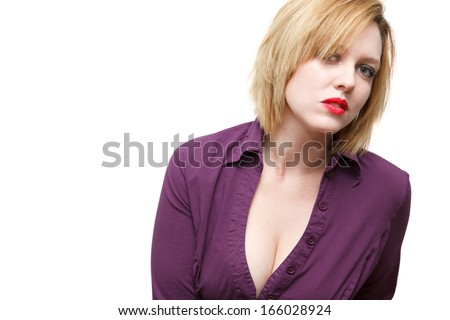 Sultry fair skinned woman with red hair and red lips wearing purple low cut blouse showing cleavage, isolated over white background. - stock photo