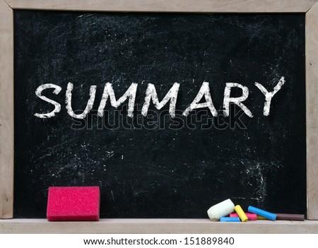 summary handwritten with white chalk on a blackboard. - stock photo