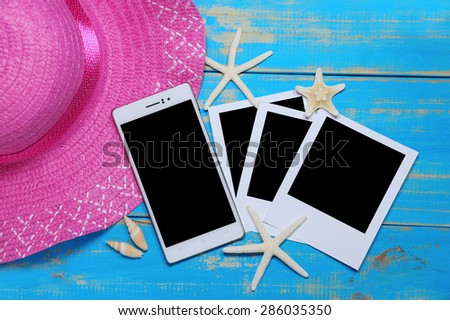 summer accessories and blank mobile  on wooden planks - stock photo