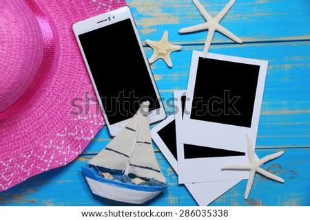 summer accessories and blank tablet on wooden planks - stock photo
