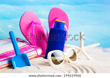 Summer accessories concept with sea background - stock photo