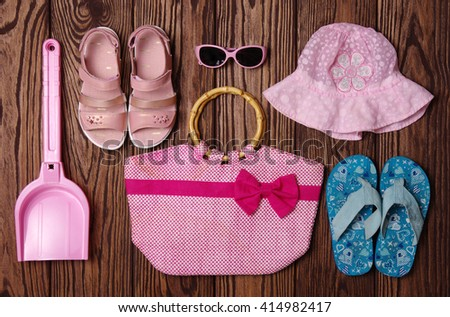 Summer accessories of girl on wooden background