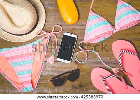 Summer accessories on an old wooden background - stock photo