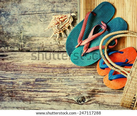 Summer accessories,sun glasses, bag and flip-flops. Closeup of summer beach bag on wooden background/ summer holidays background - stock photo