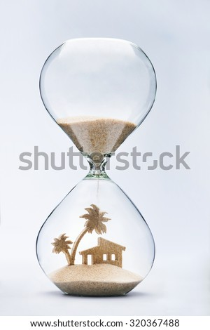 Summer accommodation concept with falling sand taking the shape of a house and palm tree - stock photo