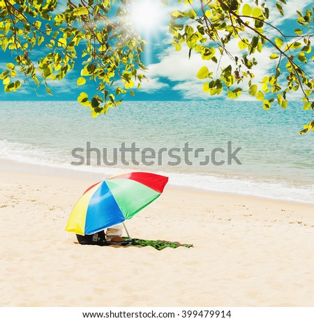 Summer and travel concept, Colorful umbrella with blue sea and white sand beach, Can be use display and product - stock photo