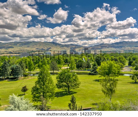 Summer at a city park with clouds - stock photo