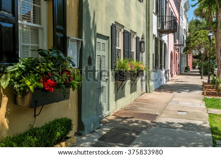 Summer at Rainbow Row - Rainbow Row, a series of colorful and well-preserved historic Georgian row houses on East Bay street, one of most popular tourist attractions in Charleston, South Carolina, USA - stock photo