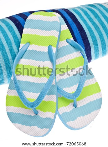 Summer at the Beach Concept with Towel and Flip Flop Sandals.
