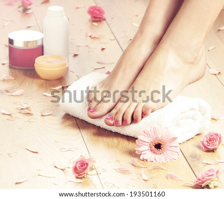 Summer background. Beautiful female legs over spa background. - stock photo
