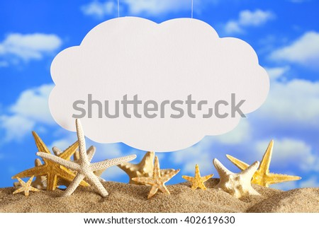 Summer background - blank paper sheet and starfish on beach - stock photo