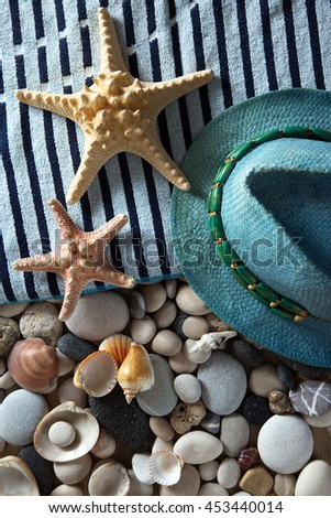Summer background of beach items, sea shells and stones - stock photo