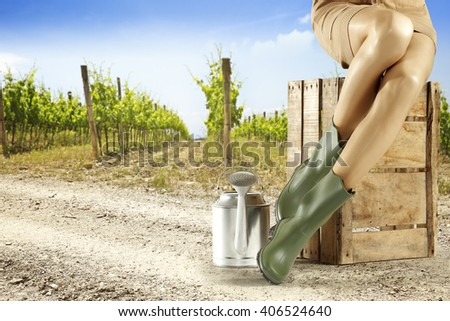 summer background of vineyard and girl legs  - stock photo