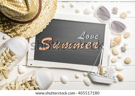 Summer background with Chalkboard, sunglasses, sailboat, seashells, sneaker shoes and straw hat with text '' Love Summer''