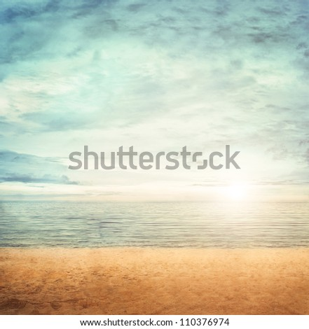 Summer background with cloudscape and calm sea water on sand beach on a tropic island - stock photo