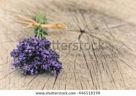 Summer background with lavender on old wood. Card with flowers.